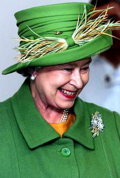 Queen Elizabeth wearing the Wattle Broach she received in 1954 from the people of Australia.