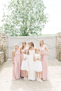 pink mix-matched bridesmaids dresses http://itgirlweddings.com/english-countryside-wedding/