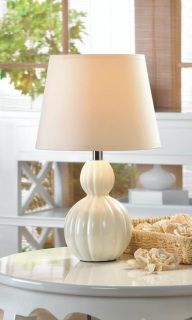 "by Gallery of Light Splendid shape and breathtaking form make this miniature table lamp a powerhouse of style. Topped with a white fabric shade, the cinched ivory ceramic base fits into just about any space and any decor style. LED E26 (60W) light bulb not included.  Base: 4 1/2"" diameter x 9 5/8"" high; shade: 8"" diameter x 6"" high; power cord is 62"" long. www.allgooddecor.com/shop.html #allgooddecor #decorations #gifts #candles #toys #discount #furniture #candleholders #home #figurines…"