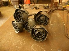 A bunch of hand-forged roses by Tom Fell - Blacksmith