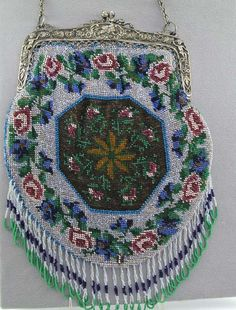 Antique beaded purse with a garland of roses on the border and an octagonal medallion at the center.