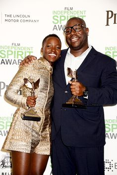 Lupita Nyong'o and Director Steve McQueen pose with the award for Best Supporting Female and Best Director for '12 Years a Slave' in the press room during the 2014 Film Independent Spirit Awards on March 1, 2014 in Santa Monica, California.