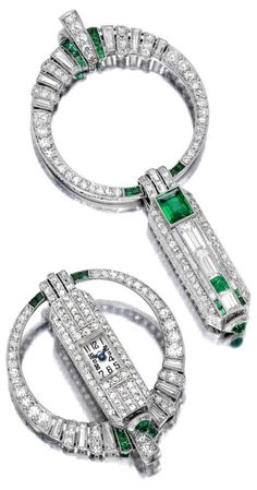 An Art Deco diamond and emerald pendant watch, Gübelin circa 1925. Of rectangular outline, manual winding movement, the silvered dial with black Arabic numerals and blued steel hands, within a pavé-set diamond case, with cabochon emerald crown, the reverse enhanced with baguette-cut diamonds and square-cut emeralds, from a similarly designed circular shaped surmount; dial signed Gübelin Lucerne, Swiss, mounted in platinum. #Gugelin #ArtDeco #watch #pendant