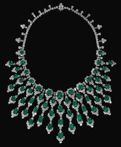 IMPRESSIVE EMERALD AND DIAMOND NECKLACE, BULGARI, CIRCA 1970. Suspending a graduated fringe of step-cut emeralds, highlighted with brilliant-cut and baguette diamonds, length approximately 370mm, signed Bulgari, case stamped Bulgari.