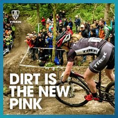 Dirt Is The New Pink  Woman in a mountain bike race.