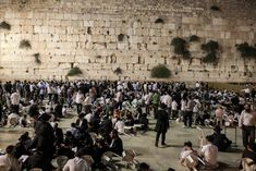 Thousands attend a Tisha B'Av prayer service at the Western Wall in Jerusalem. Mourning and remembering the destruction of the temple, what happende twice. First Babylon when they went into exhile as well and later 600 years the Romans on the same date.