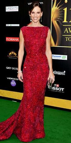 Hilary Swank wore a red embellished Elie Saab gown with a high neckline and a small train. Hilary is elegant and beautiful in red!