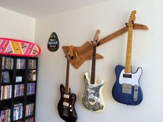 Musician's Guide To Music Instrument And Equipment Storage Guitar Hanger, Guitar Wall, Guitar Room, Music Guitar, Used Guitars, Unique Guitars, Wooden Guitar Stand, Guitar Storage, Bass Ukulele