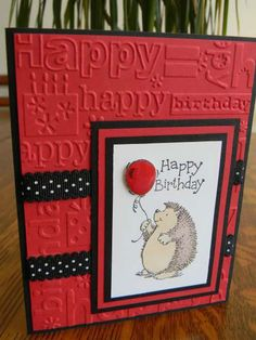 handmade birthday card ... red with black and white ... birthday words embossing folder ... multi-layered focal block with cute hedgehog holdin a balloon ...