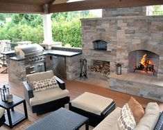 An outdoor kitchen with stone and natural wood elements, black wicker furniture, and several cooking options. Source: https://www.zillow.com/digs/Home-Stratosphere-boards/Luxury-Kitchens/