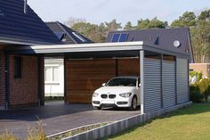 Love this carport. Especially the back wooden wall - Liz
