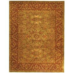 The elegant handmade wool rug seen here features an intricate oriental pattern and design. The colors on the rug are a blend of rust, green, and red, with some ivory as well. This wool rug will look stunning as decor in many homes. Measures 7'6' x 9'6'.