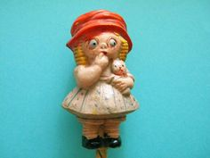 Antique Celluloid Rattle Chloe Preston Girl with Kitten Baby Crib Toy by SongbirdSalvation on Etsy https://www.etsy.com/listing/519512529/antique-celluloid-rattle-chloe-preston