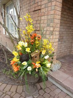 Spring! An adorable bird house featured in a lovely spring urn. Nothing says spring like bird houses and we have several to choose from which we can incorporate into your look! Created by www.grandentrancedesign.com  #spring
