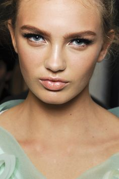 Nude glowing skin, soft peach cheeks, soft peach lips, fierce brows, and dramatic lashes at Louis Vuitton Spring 2012 Ready-to-Wear