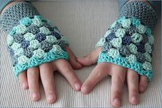 Use any type of light worsted yarn in 4 colours, to create these fingerless gloves, which reflect every crochet artist's secret (or not-so-secret) obsession with granny squares. But instead of making a square, you create stripes that build up to an extremely appealing effect.