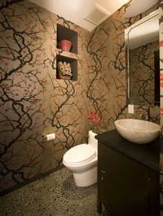 Dramatic Japanese style wall covering, espresso vanity and moody lighting give this powder room a unique look