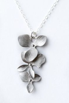 This beautiful sterling silver necklace with white gold plated orchids dangling vertical is stunning on!    Total length is 16″    Matching bracelet and earrings are available. $59 Sterling Silver Necklaces, Orchids, Dangles, White Gold, Inspired, Bracelets, Earrings, Inspiration, Beautiful