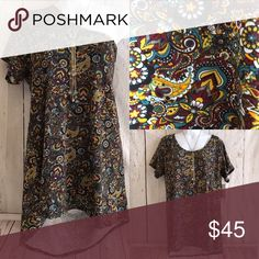 Paisley Classic Tee XL LuLaRoe Classic T. Size XL. If your smaller you can play around with the Tee and create different looks. Deep burgundy and gold yellow colors with hints or bright orange. LuLaRoe Tops Tees - Short Sleeve