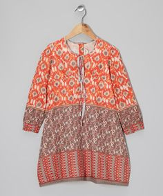 Classic, heirloom-quality style mingles with an Indian-inspired print on this darling dress. A tied neckline and back buttons help this cotton wonder blossom as a style centerpiece.