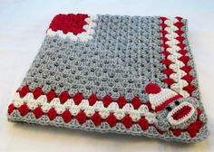 Handmade Sock Monkey Baby Blanket.  Measures 30 x 30 and is made from a soft 100% acrylic yarn. Crocheted in the traditional granny square pattern with a crocheted sock monkey applique.  Color: Silver Gray, Off White, Red, & a small amount of black. Machine washable and dryable.  Ready to Ship!  Hand crocheted by me (Littledarlynns) and comes from a non-smoking home.  Custom orders are also welcome if you would like this blanket in a different color or size.  Please contact me if you have…