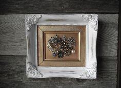 Old brooch framed ..cool idea