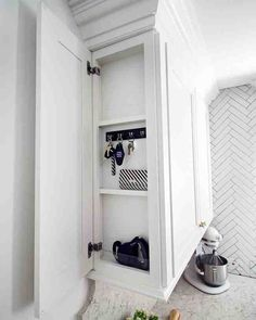 Surprising Space-Savers - This Martha Stewart Living Message Center cabinet is almost like a hidden door! It's the perfect place to hold Kristin's keys or other odds and ends.Drawer organizers are essential for taming your utensils.