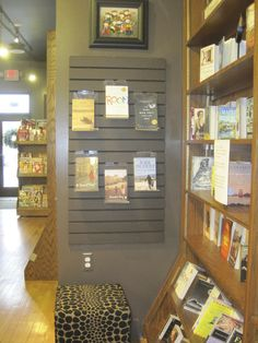 If you want a piece of slatwall to be less visible, paint it the same color as the space behind. Bookstore Design, Slat Wall, Circus Party, Bookstores, Job Opening, Java, Promotion, Commercial, Elephant
