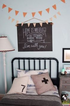 Jonas says his favorite colors are orange and black!-- so I'm thinking this color scheme would work best in his new room. Bluish gray with black and orange accents.