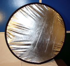 DIY photo reflector using springy wire and metallic lame fabric.