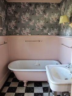Pink tub, check floor, floral walls