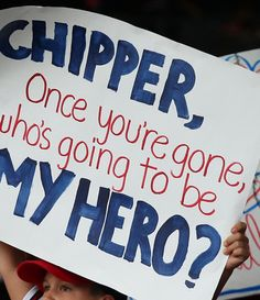 A Young Fan stands up for Chipper Jones #10 of the Atlanta Braves during the game between the Atlanta Braves against the Washington Nationals at Turner Field