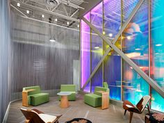 A dichroic wonder wall anchors this collaborative office space.