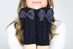 fingerless mittens, fingerless knit gloves with bow, black knit gloves, OTHER COLORS, bow gloves, knit bow gloves. $32.50, via Etsy.