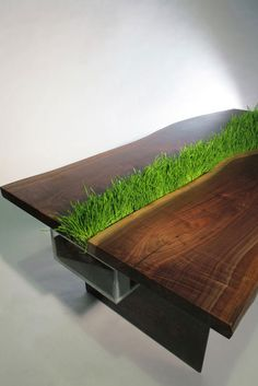 wood table with grass in the middle.