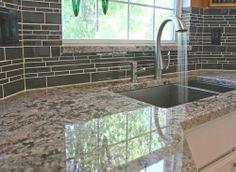 Kitchen backsplash- Glass tile is wrapped around the corner of the window.  I need corner glass tile!!