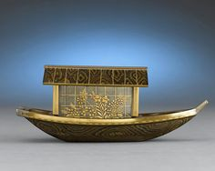 This dimentutive Japanese Meiji-period lacquered boat is distinguished by its exceptional craftsmanship. The vesel exhibits a phenomenal artistry, enveloped with nashiji, hirame and kirikane decoration over the entire boat. Most likely used as an incense burner, the boat's roof and cabin separate from the hull, allowing aroma to escape and fill the air.