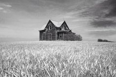 North Dakota farm house,North Dakota, black and white, grass, wheat field, Black and white photography.  John Piepkorn photography. An abandoned farmhouse in central North Dakota. Digital photograph available in print sizes up to 20 x 30.