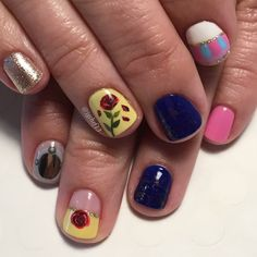 Beauty and the Beast Gel Manicure. Thumbs are pink and gold glitter. See more of my designs on my nail board @jgchef13 or my IG account @jgchef13.
