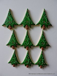 Whimsical Style Christmas Tree Sugar cookies for the Holidays - comes in three sizes. Can be decorated in your choice of colors. If no request is made, they will be decorated in green with accents. The three sizes are shown in the photos. Listing is for a platter set of 36 cookies, 12 of each