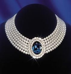 This spectacular seven-strand pearl choker with a large blue sapphire surrounded by two rows of diamonds was a favorite piece of jewelry owned by HRH Diana, Princess of Wales