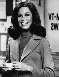 Mary Tyler Moore drinking in the newsroom.