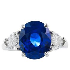 6.52 Carat Ceylon Sapphire and Heart Shaped Diamond Three Stone Ring
