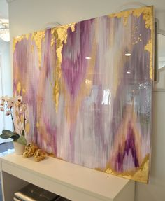 one of a kind large abstract artwork is textured with a mixture of acrylic paints, recycled glass, and resin coating to create a truly unique and serene abstract original. The painting has a glass coat layer of epoxy resin to add a thick high gloss sheen to piece. Looks beautiful in natural light!!  This Ikat pattern style painting includes shades of gray white, gold, purple iridescent glitter, and touches of silver and gold leaf.  This is a signed original gallery wrapped heavy duty canvas…