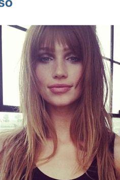 Long hair with bangs & face framing.