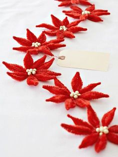 Make your own poinsettias using chenille for a Victorian-inspired adaptation of the beloved flower. Bend and twist four stems together and then wire beads to the center. Craft and join multiples for a fabulous garland.