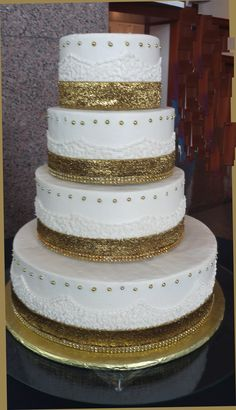 Gold Sparkle was pretty much the theme for this Indian wedding. Gold rhinestones, gold glitter and gold dragees for decoration of cake. It even had rhinestones around the board for that extra splash. It's awaiting the flowers by the florist so we probably won't get a finished picture. That's always sad...send your cake lady a finished pictures. She's worked hard for you and needs a picture of his/her final cake. That's so very nice when it happens!! austinweddingcakelady@gmail.com