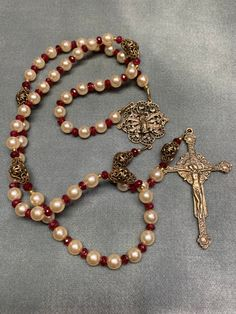 Pearl and Ruby Rosary Bronze Handmade Heirloom Hand cast Crucifix, center by HeartFelt Rosaries Bead Earrings, Beaded Necklace, Beaded Bracelets, Hand Cast, It Cast, Rosary Beads, Religious Jewelry, Organza Gift Bags, Crucifix