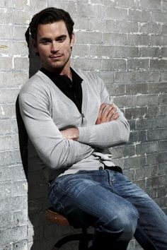 Matt Bomer-grey cardigan over black button up with jeans. This man is too pretty :)