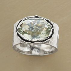 GREEN AMETHYST OASIS RING. Beautiful facets and a wavy silver bezel make this such an ocean piece.